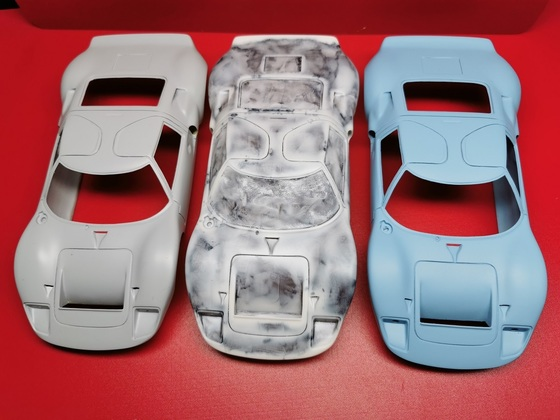 from left to right:   Master Model - GFK Curbside Body -  cuttet out and painted Body